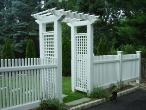 Archway Trellis by a white picket fence